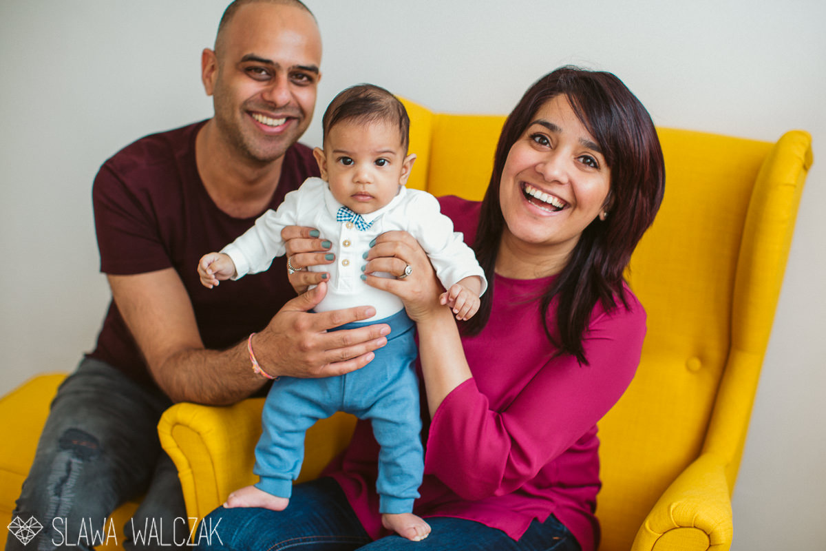 happy family posing for their lifestyle family photography in their london house