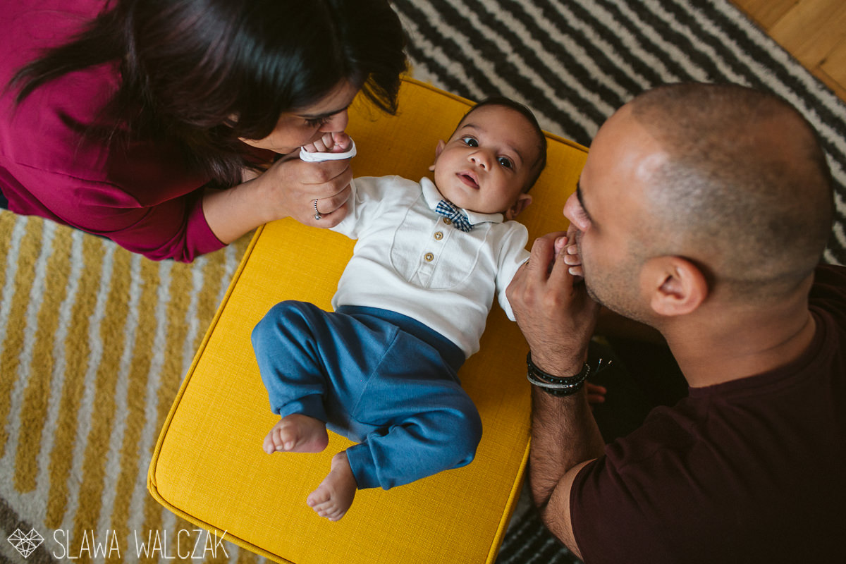 parents kissing their child during a family photography session in London