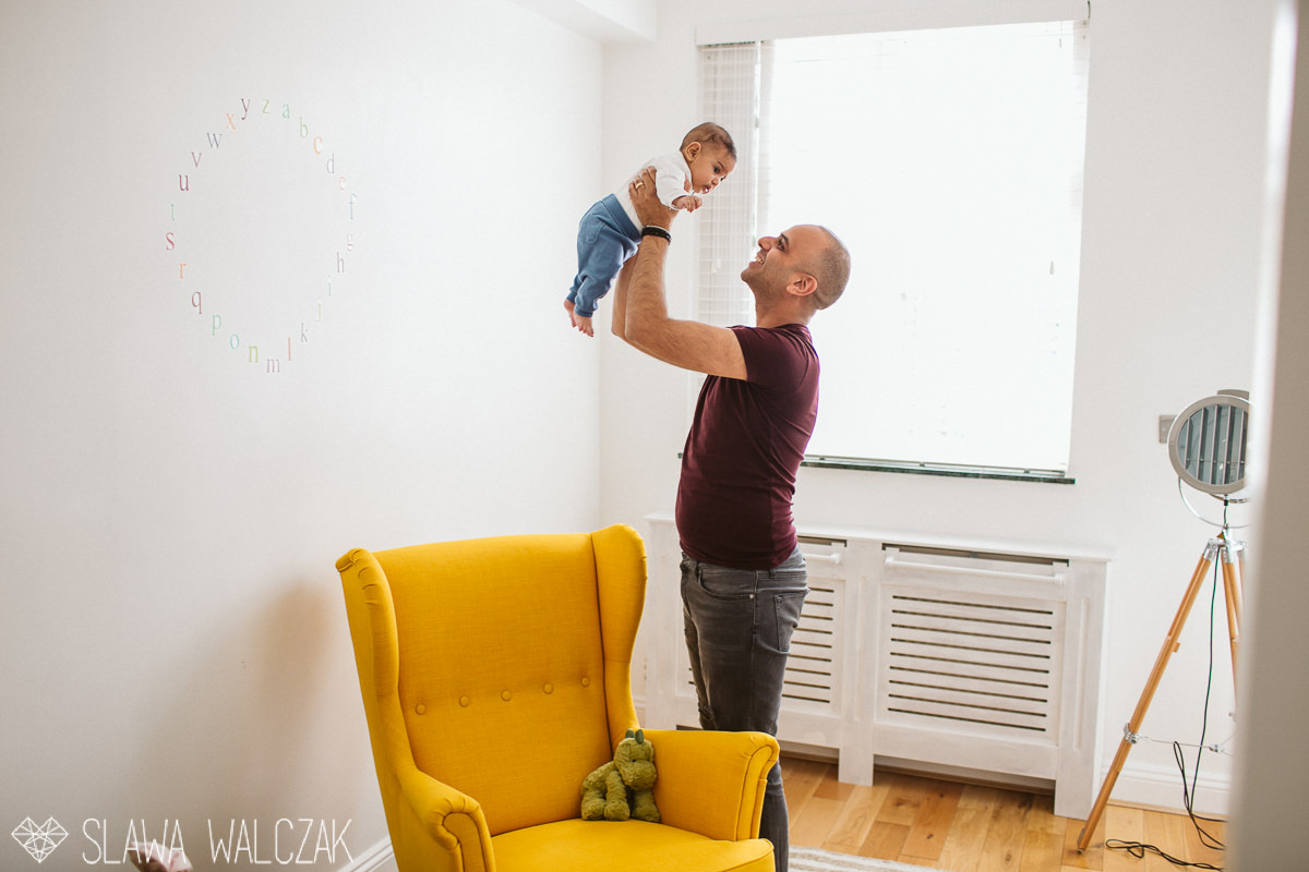 Father playing with his few months old son during a london family photography session