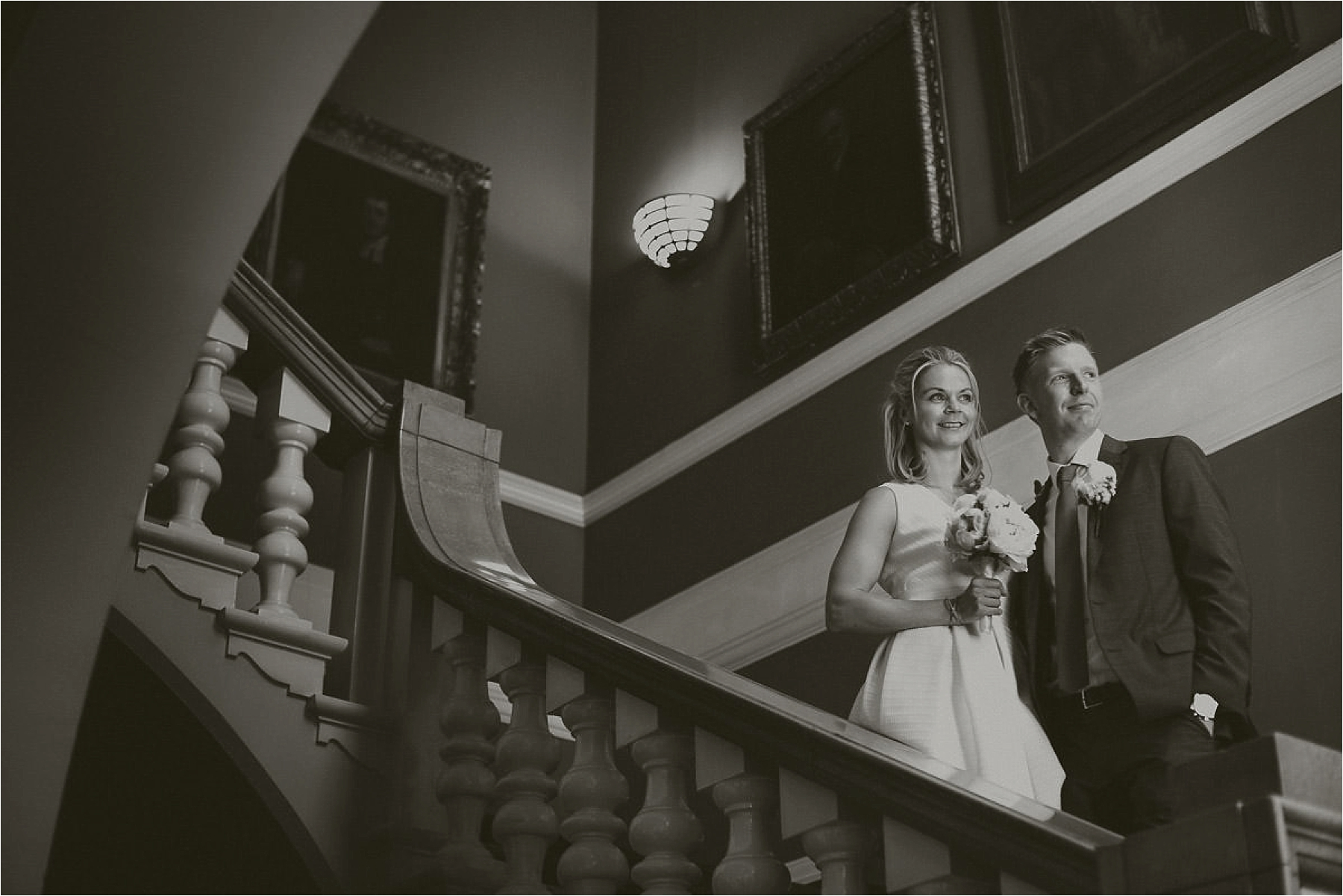 couple photos on the stairs in chelsea register office