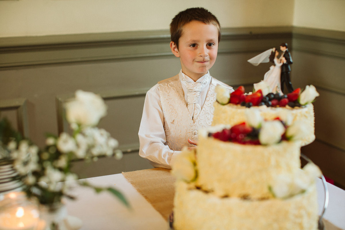 usher standing by the cake during a DIY Wedding Little Venice London