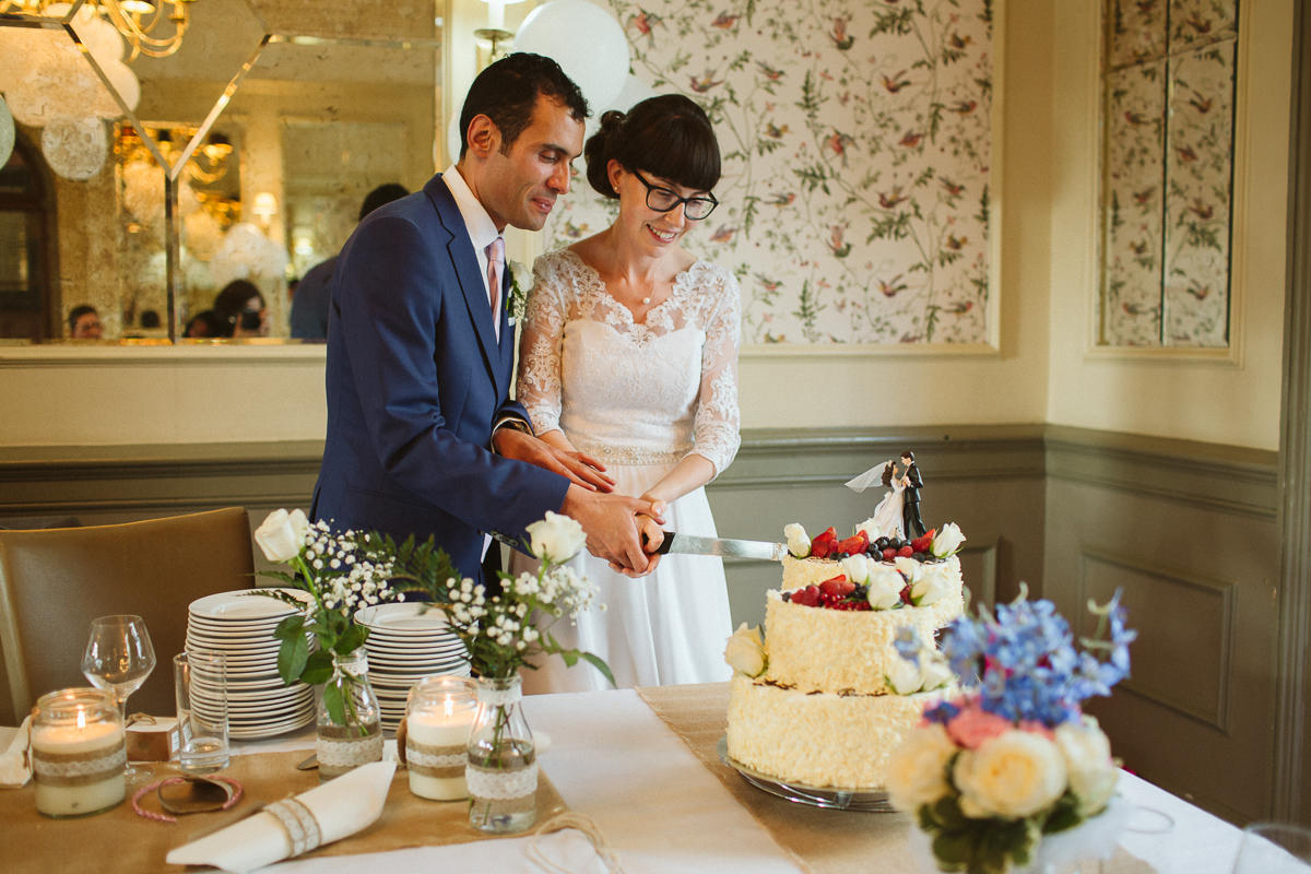 couple cutting a cake during a DIY Wedding Little Venice London