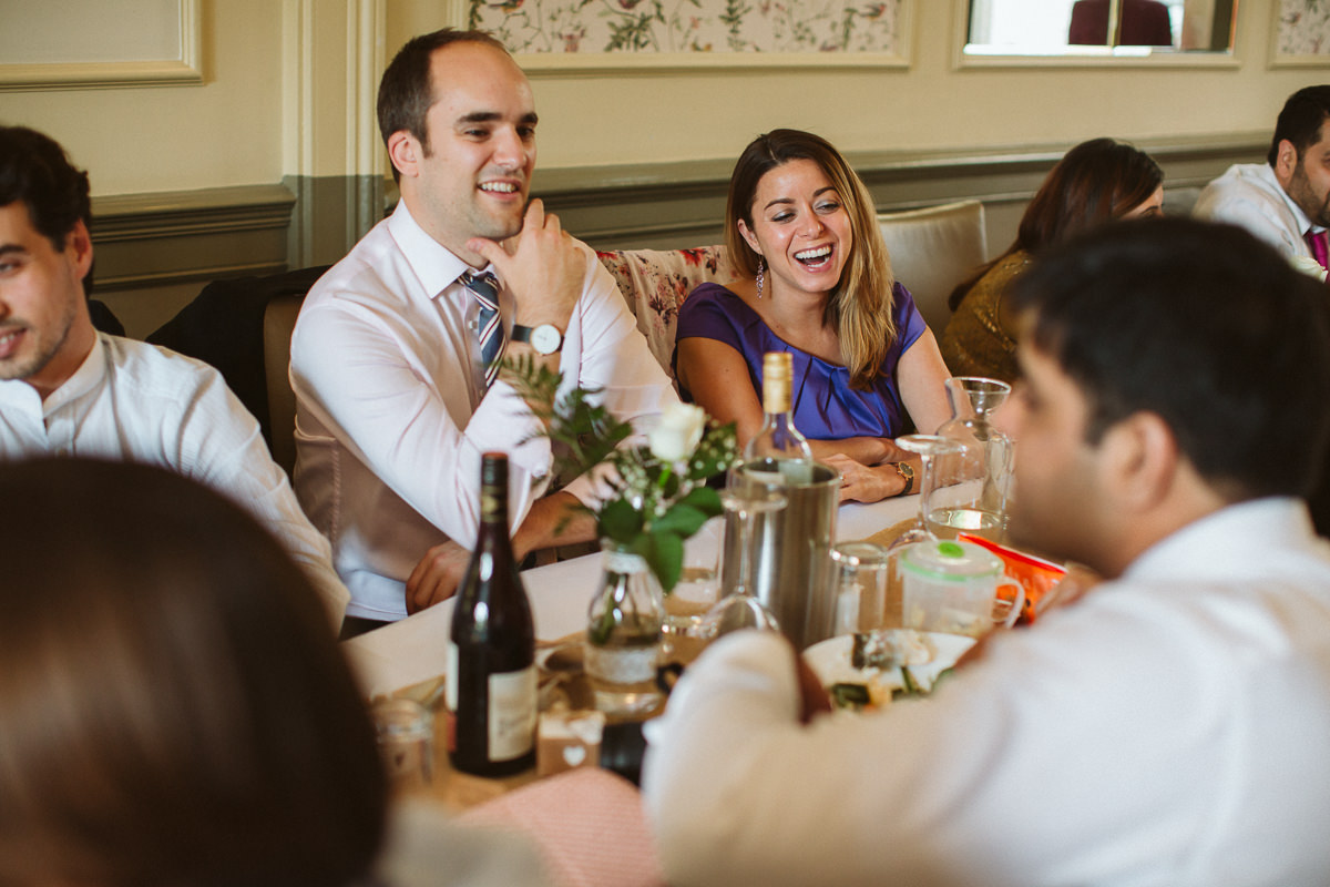 guests laughing at a Little Venice wedding in London