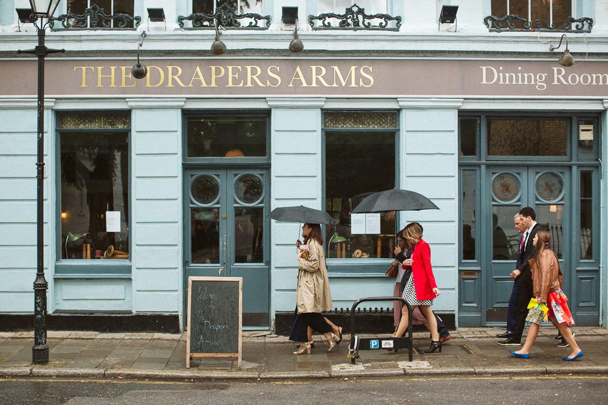 wedding guests entering th Drapers Arms Pub in Islington