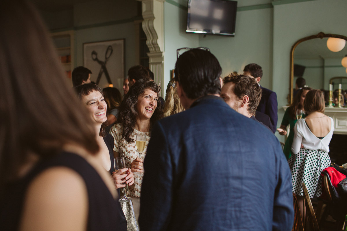guests having fun during a very informal wedding at the Drapers Arms pub in Islington