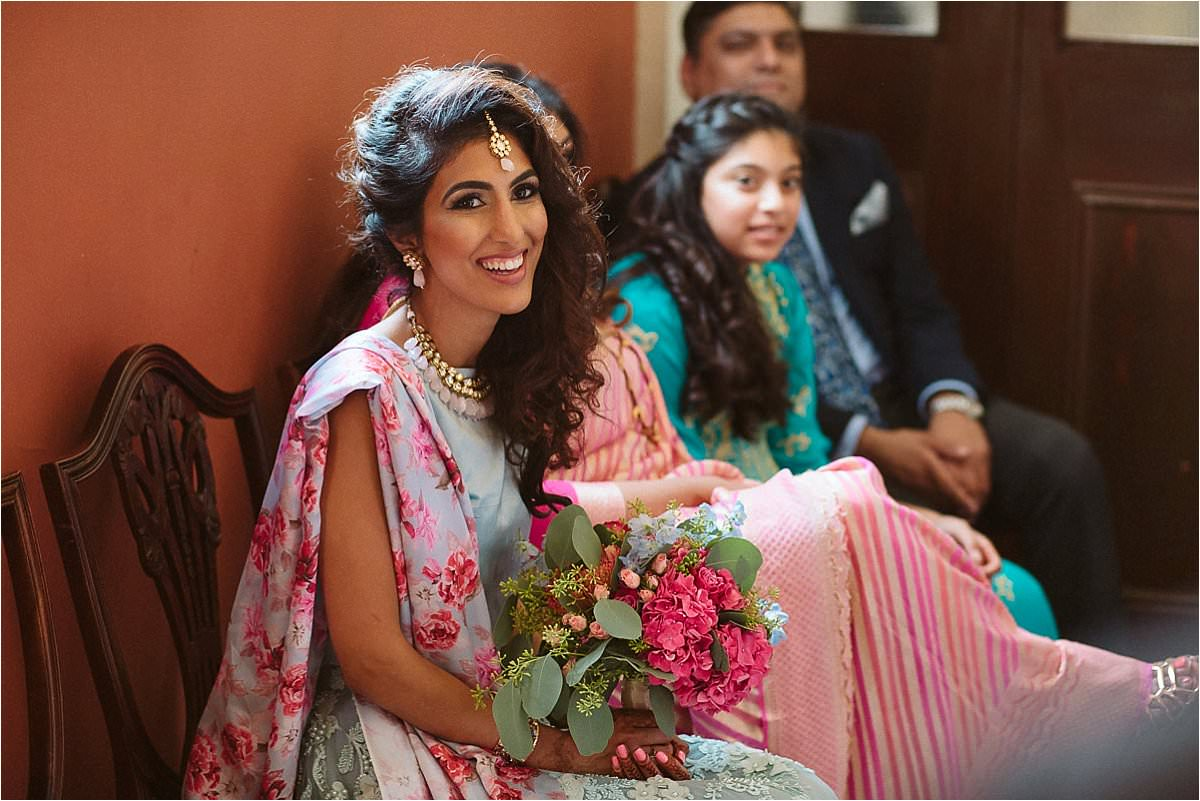 asian bride waiting for her wedding at Old Chelsea Town Hall in London