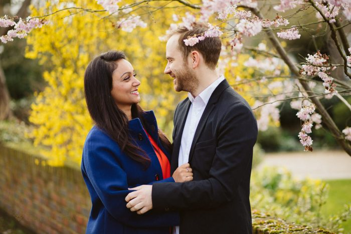 couple posing in the blossom ofr their engagement photos