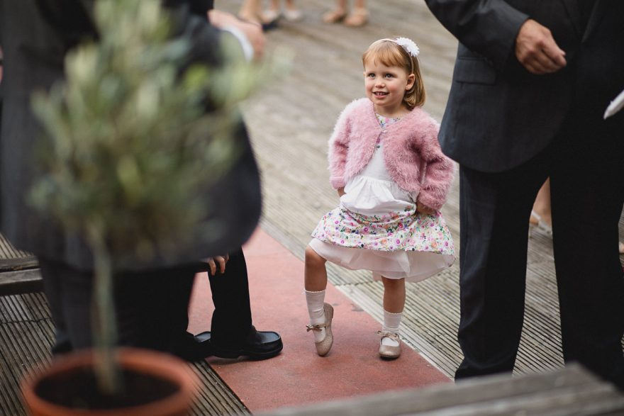 little girl posing for a photo during a wedding in Greenwich Yacht Club