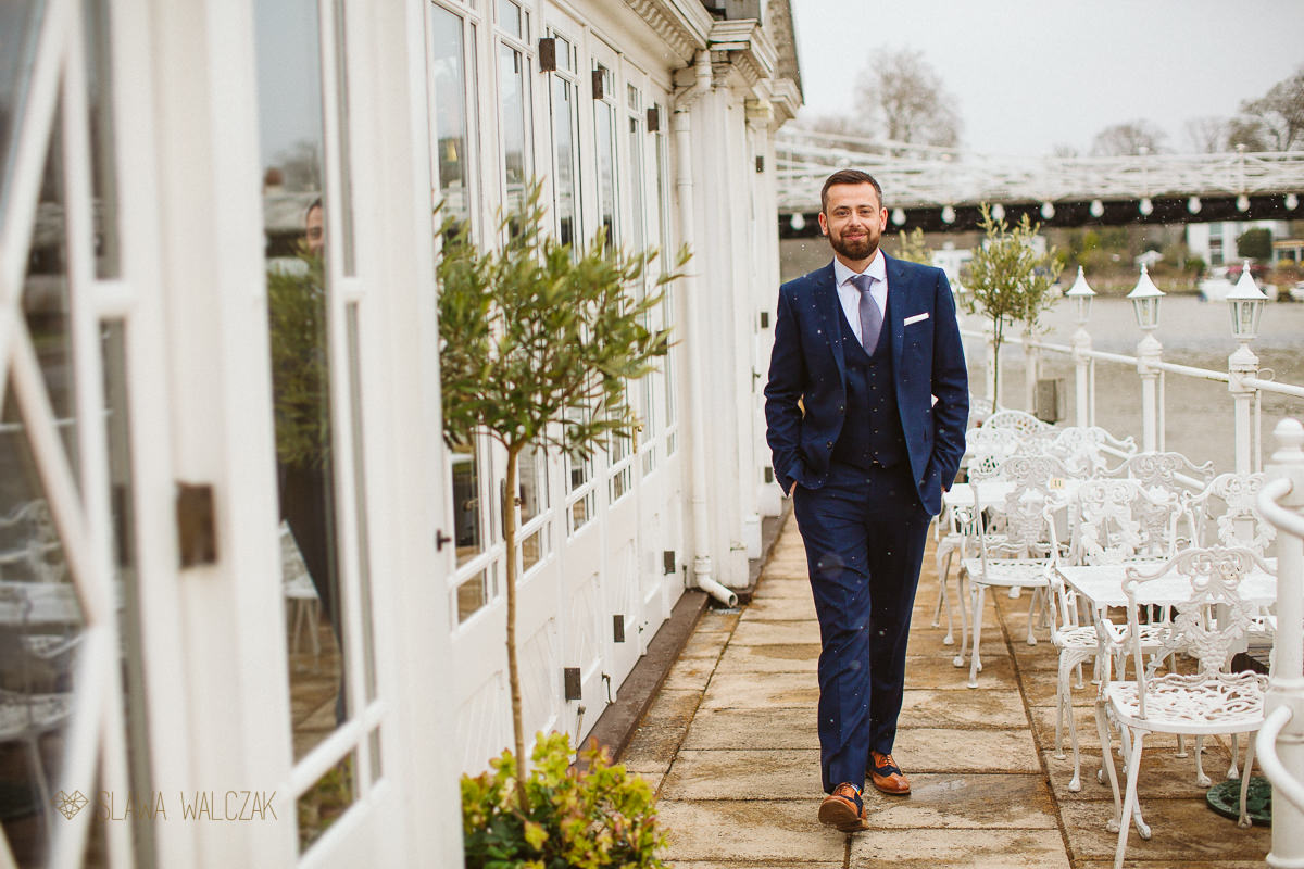 groom posing for photos at a Compleat Angler Marlow Wedding Photography