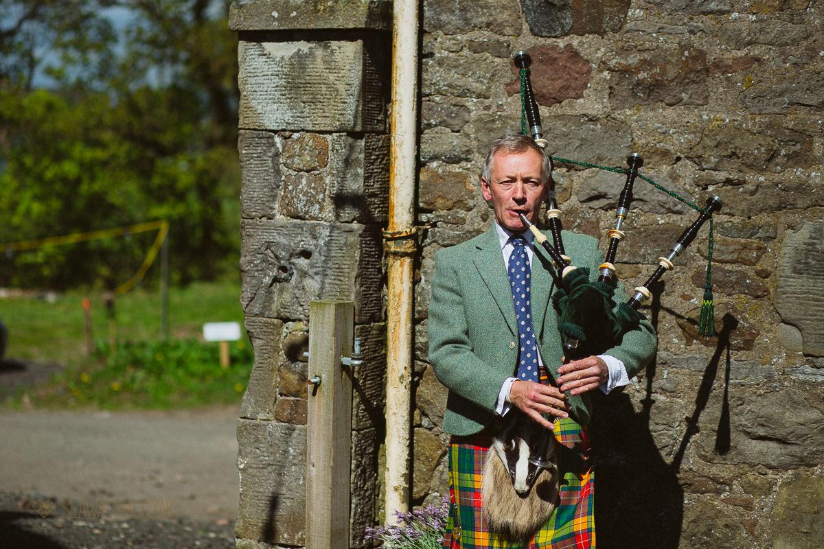 piper at a scotish wedding in Cockdurno Farm Balerno Scotland