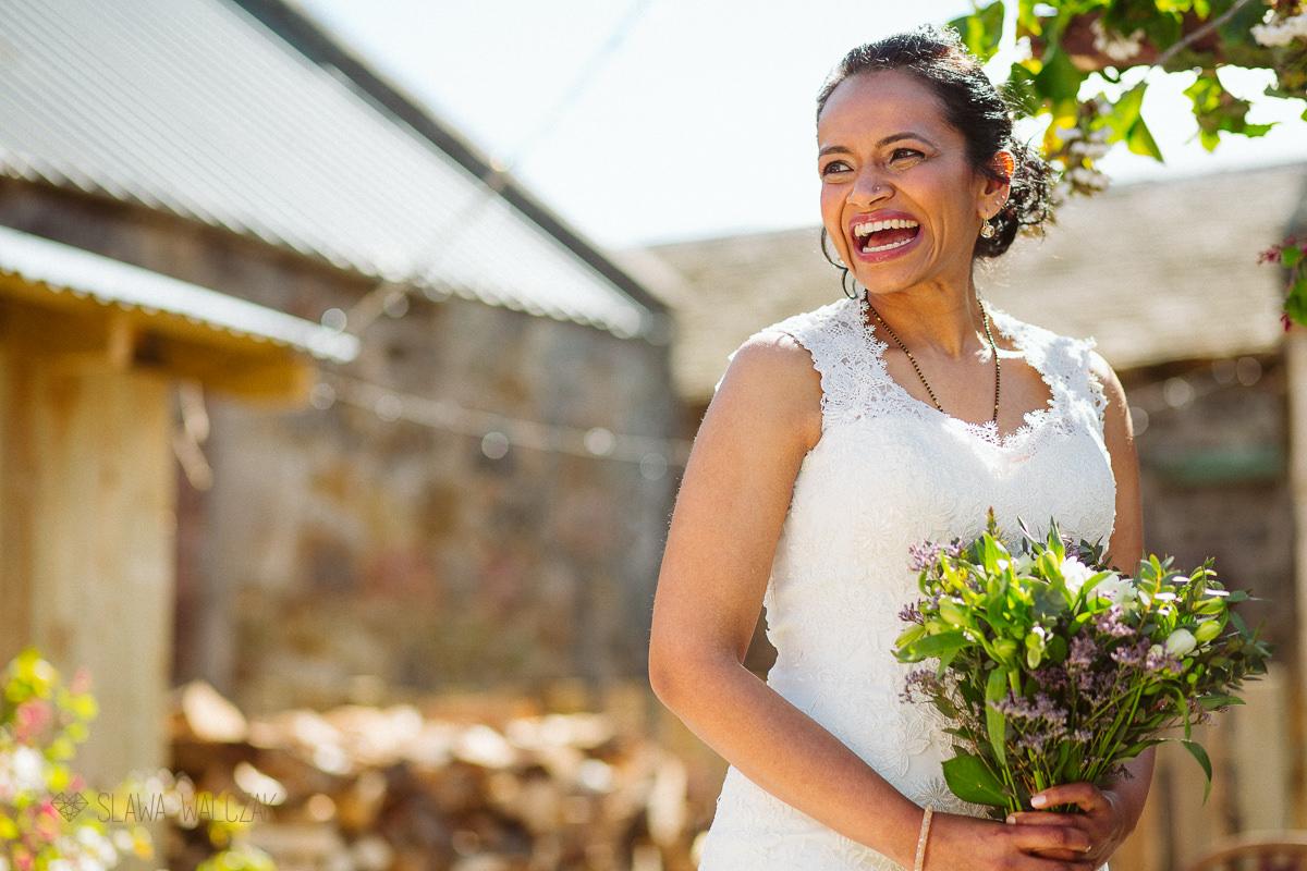 bride smiling at her wedding ceremony in Cockdurno Farmhouse in Balerno Scotland