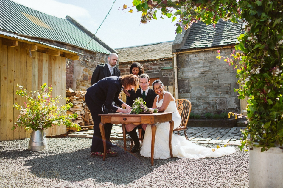 signing of a registry at a scottish wedding in Cockdurno Farmhouse