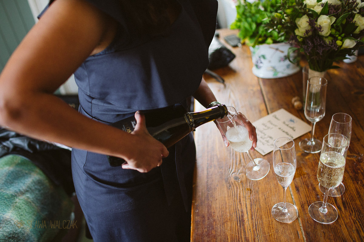 humanist wedding in Scotland bridesmaid pouring champagne