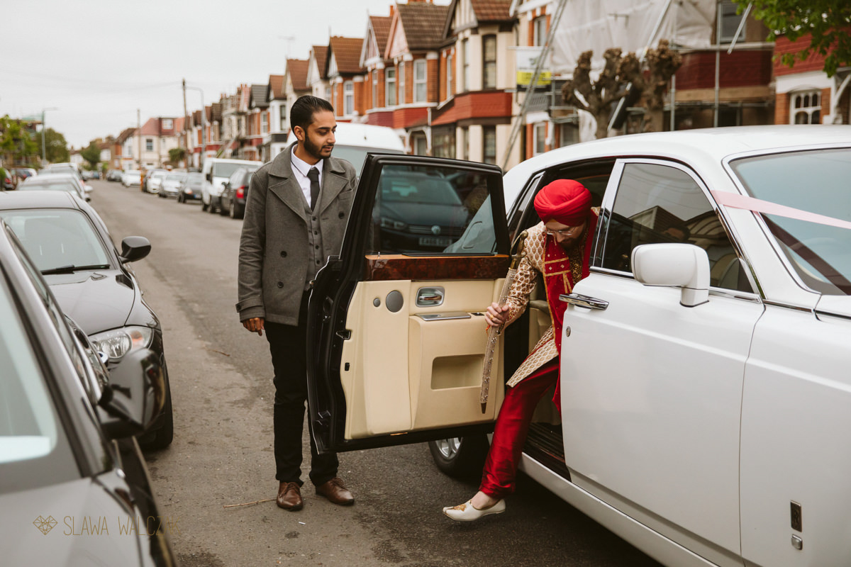 sikh groom getting out of the car