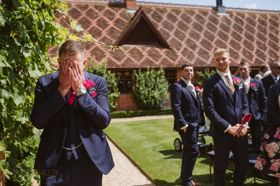 groom awaiting his bride at a wedding in The Dairy in Waddesdon