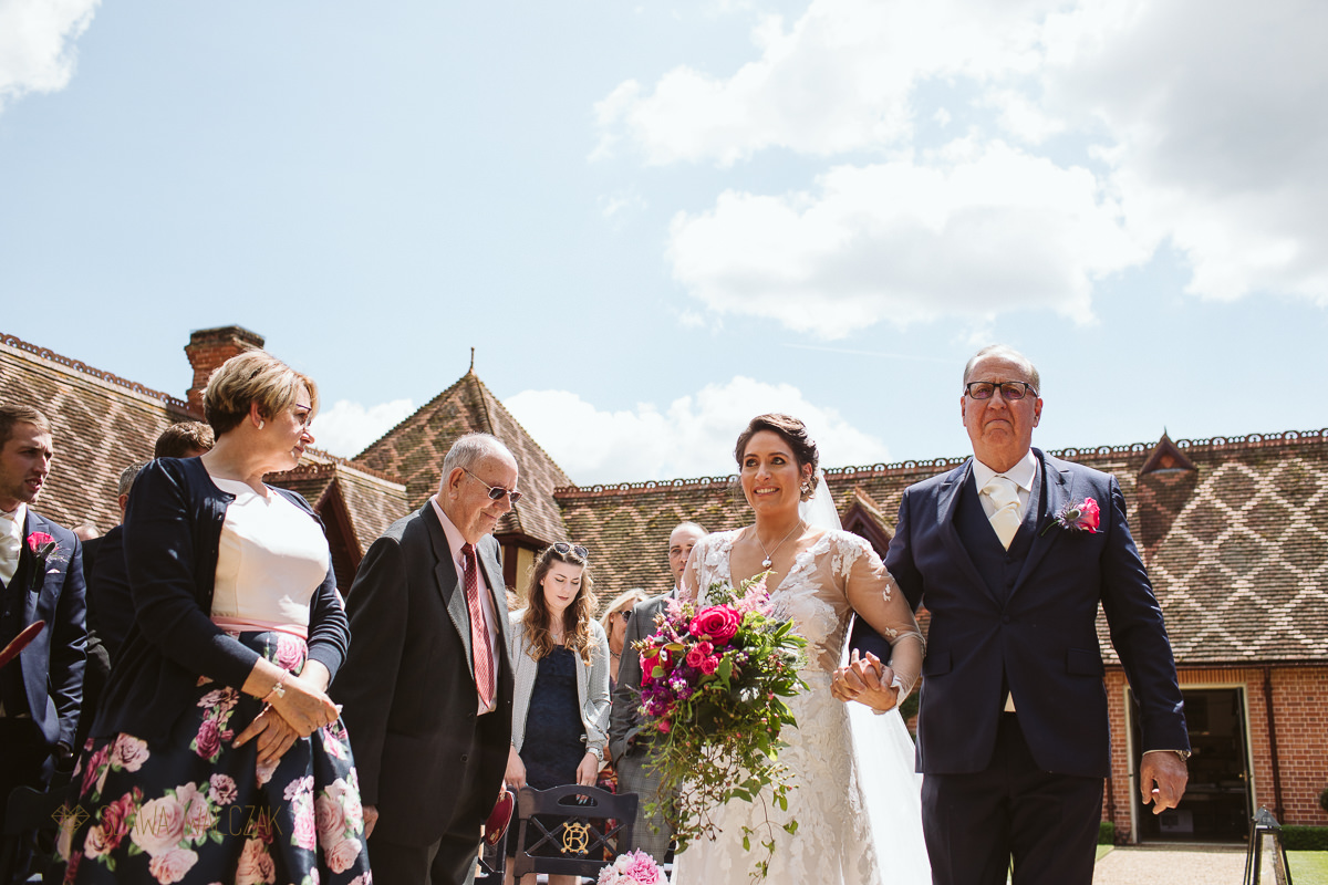 emotional bride being walked down the aisle by her father at the Dairy in Waddesdon