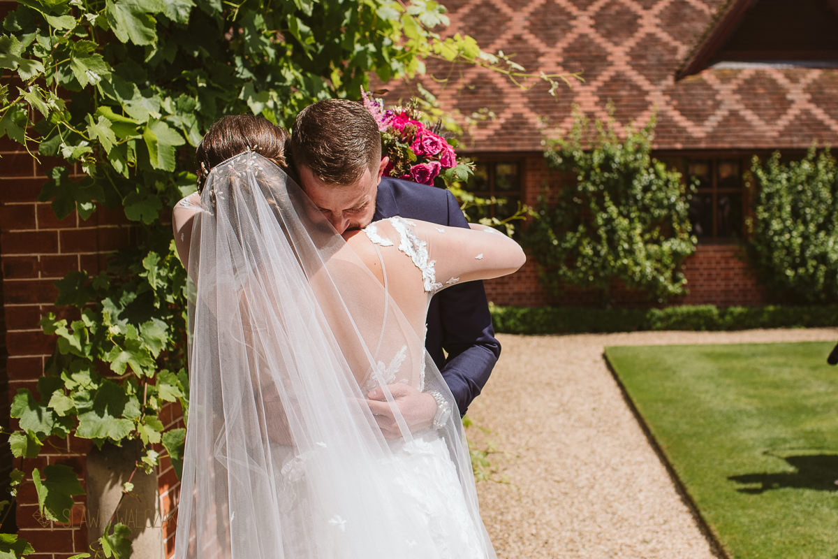 bride and groom hug at an outdoor wedding in the Dairy Waddesdon Manor