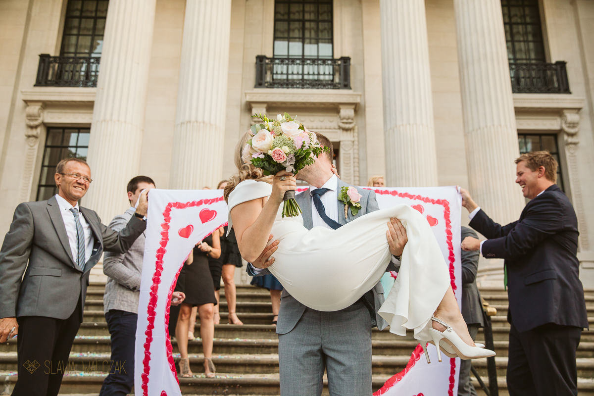 Bride and groom posing on the staircase of the Old Marylebone Town Hall