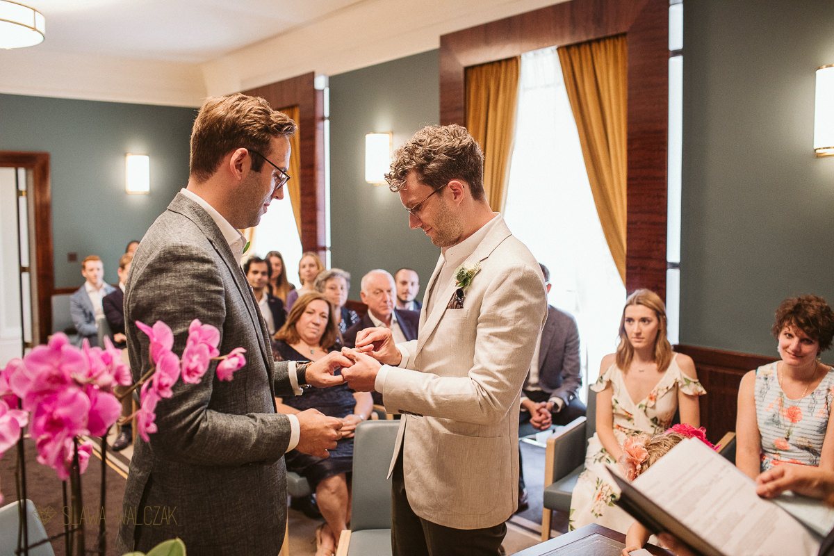 ring exchange at a same sex wedding in London Hackney Town Hall