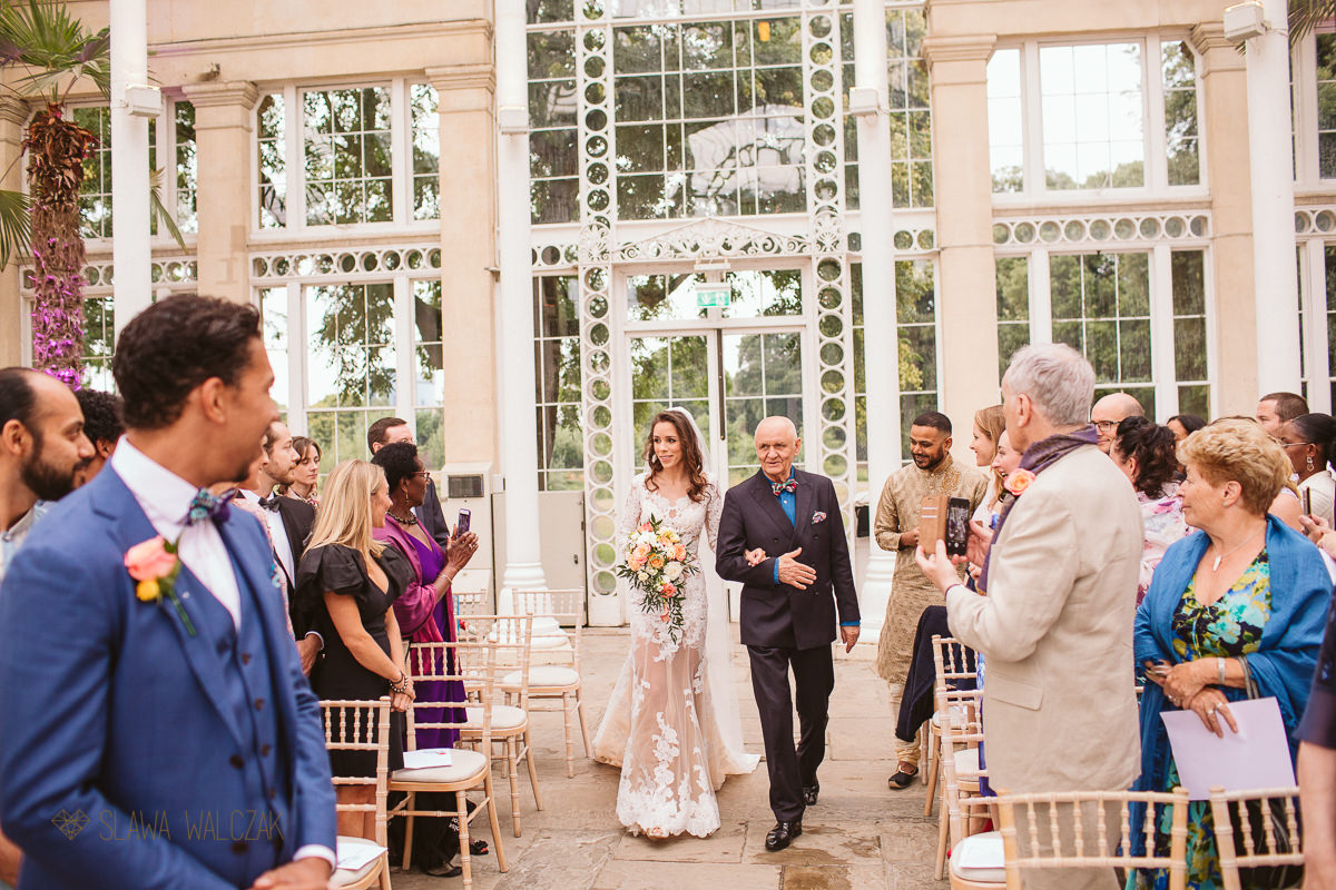 Father walking the bride down the aisle at a Syon Psrk wedding