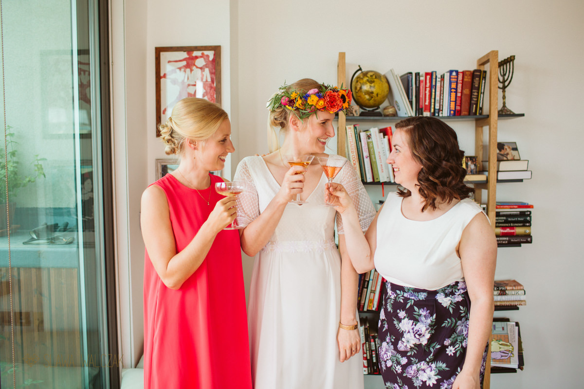 bride and her bridesmaids making at toast at a Burgh House wedding