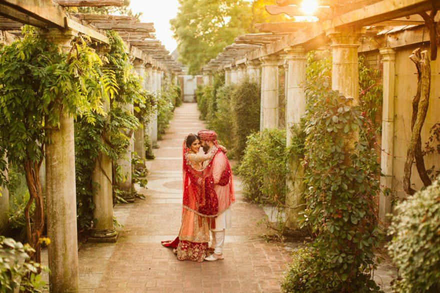 Muslim Couple posing for their wedding photos taken by a female wedding photographer