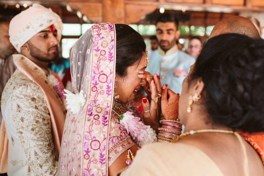 photo of a Vidai at a Hindu Wedding taken by a female photographer