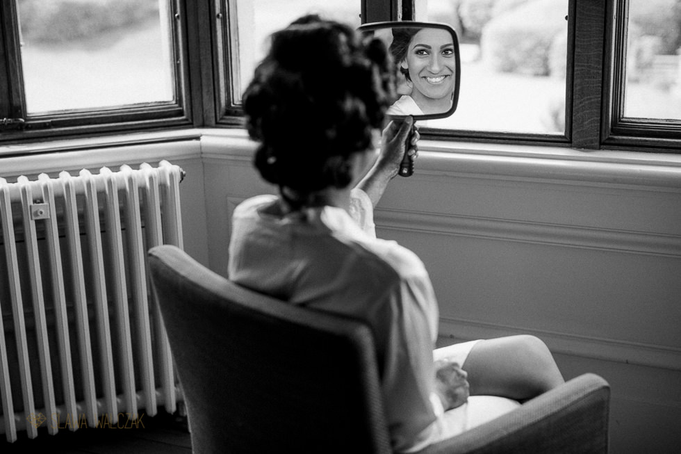 Bride getting ready for her wedding at Harlaxton Manor