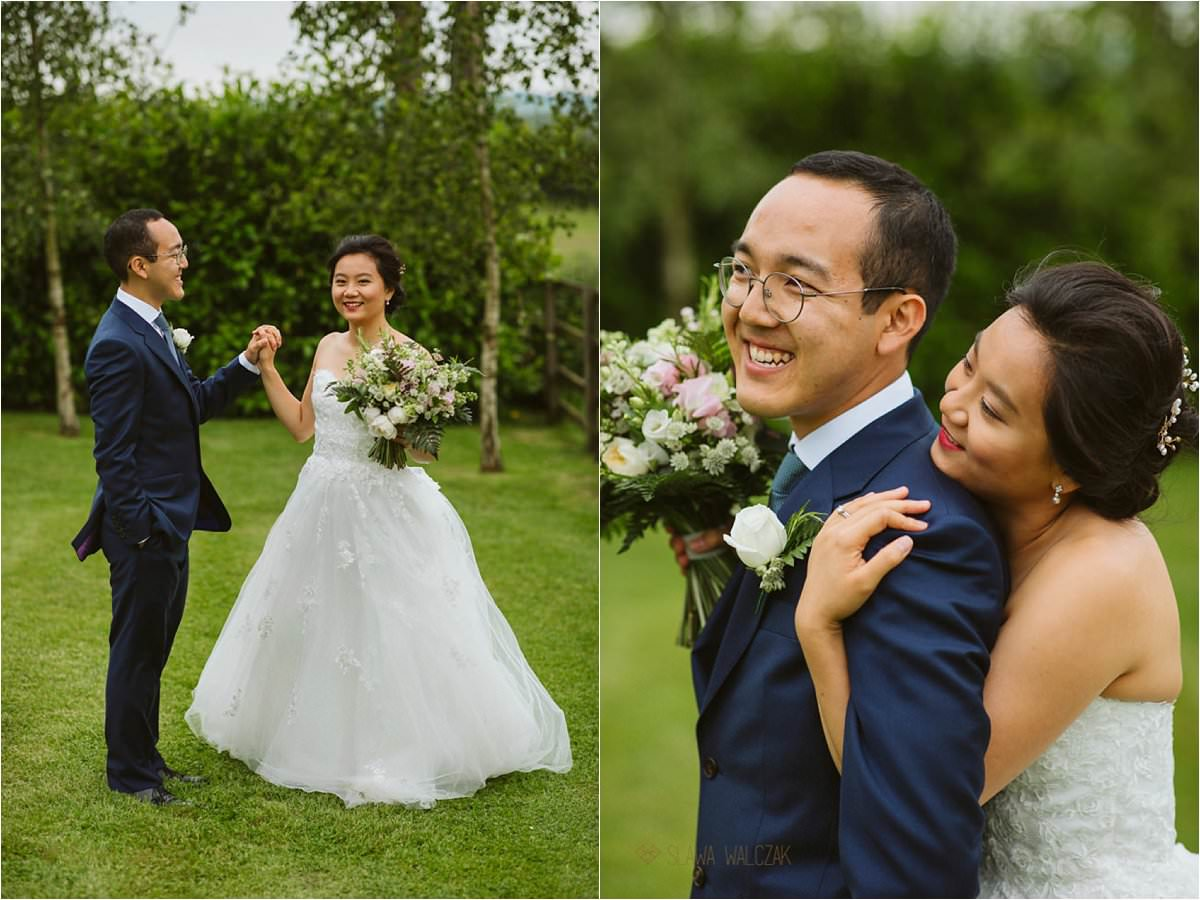 chinese couple posing for their wedding photos at Hyde Barn Cotswolds