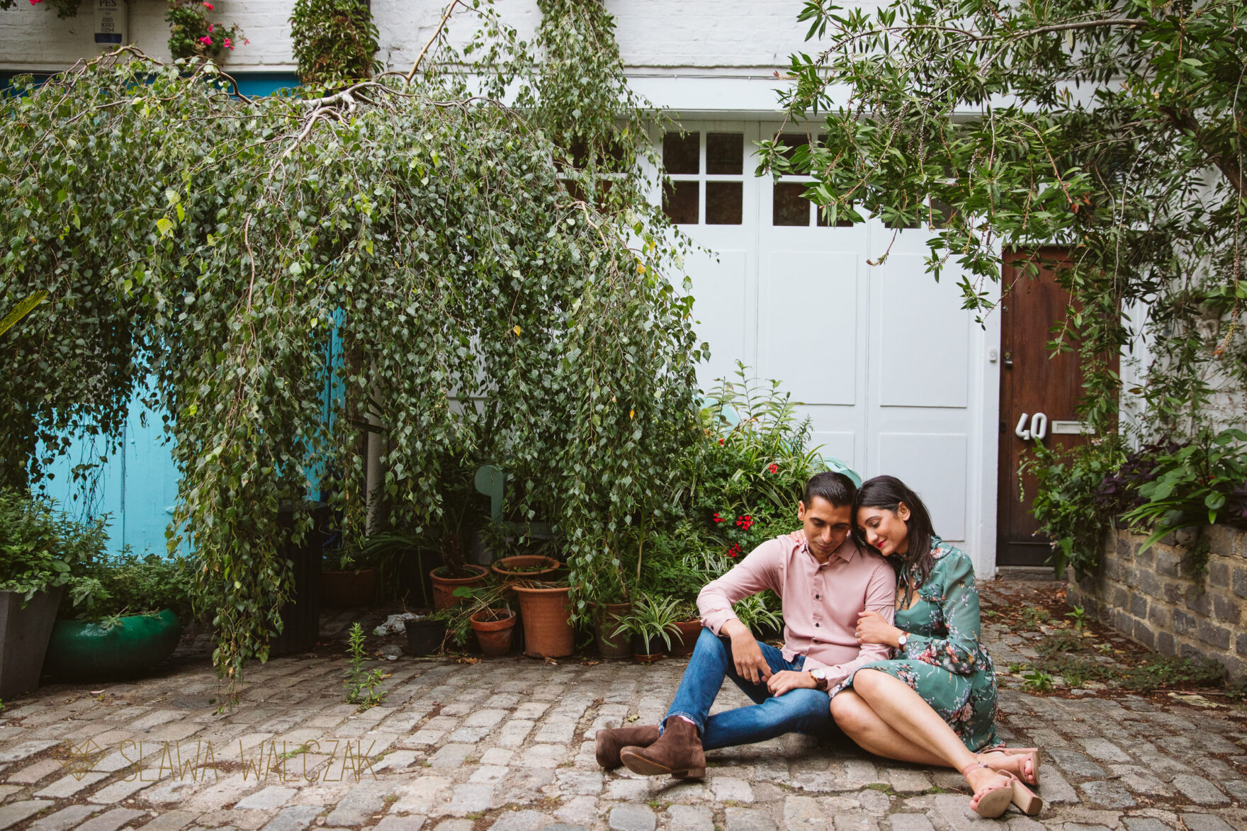 couple cuddling up for their engagement photo shoot in London