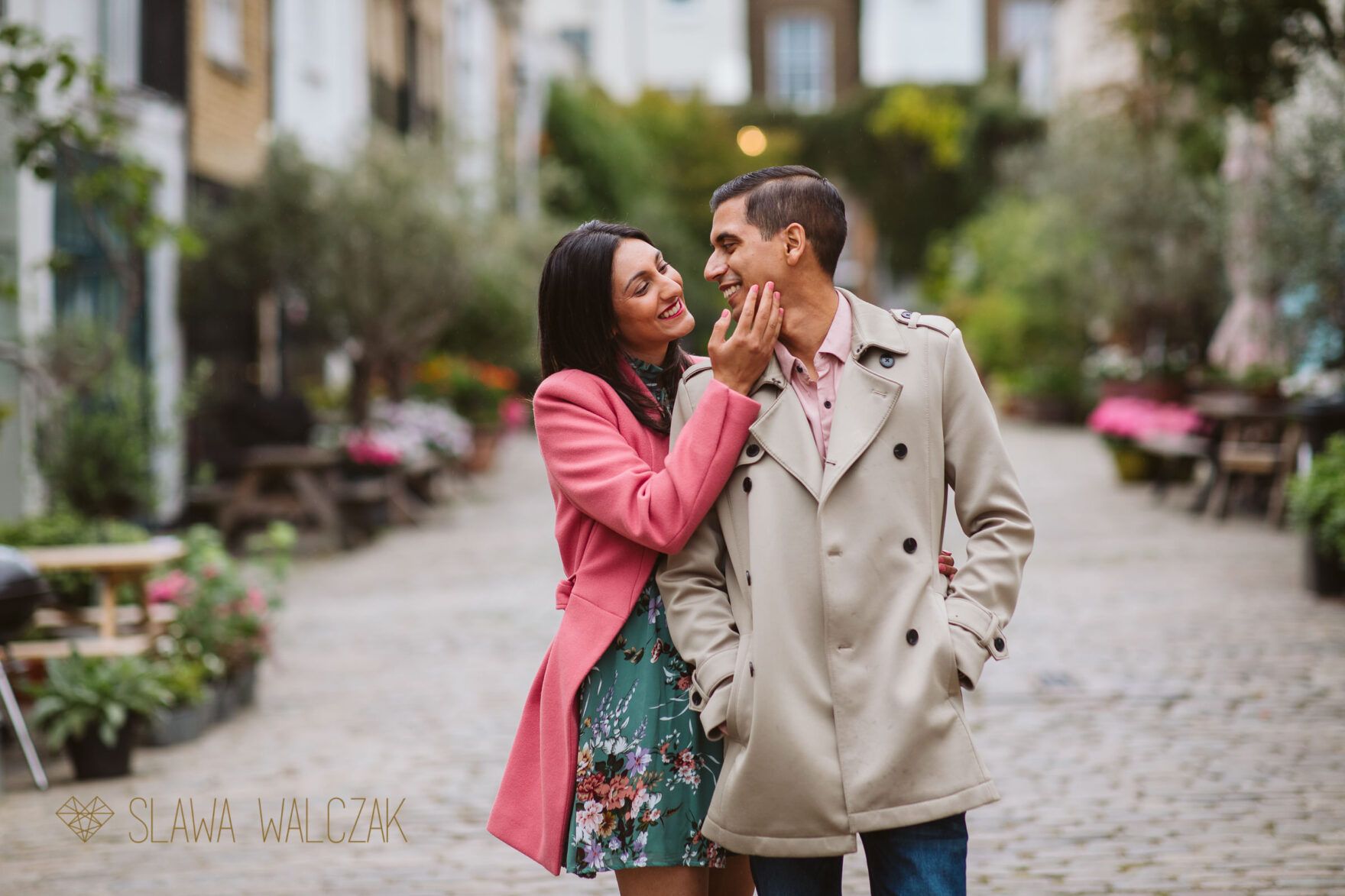 Asian couple posing for photos on London Streets