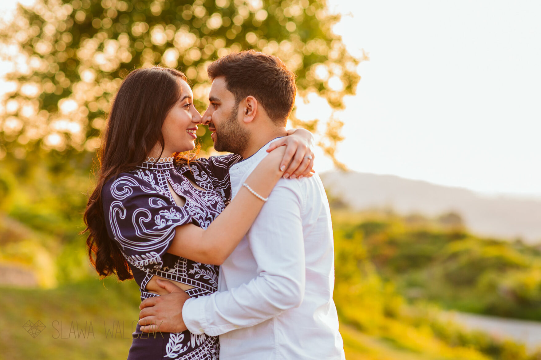 a loved up couple posing for their engagement photos in Cheltenham