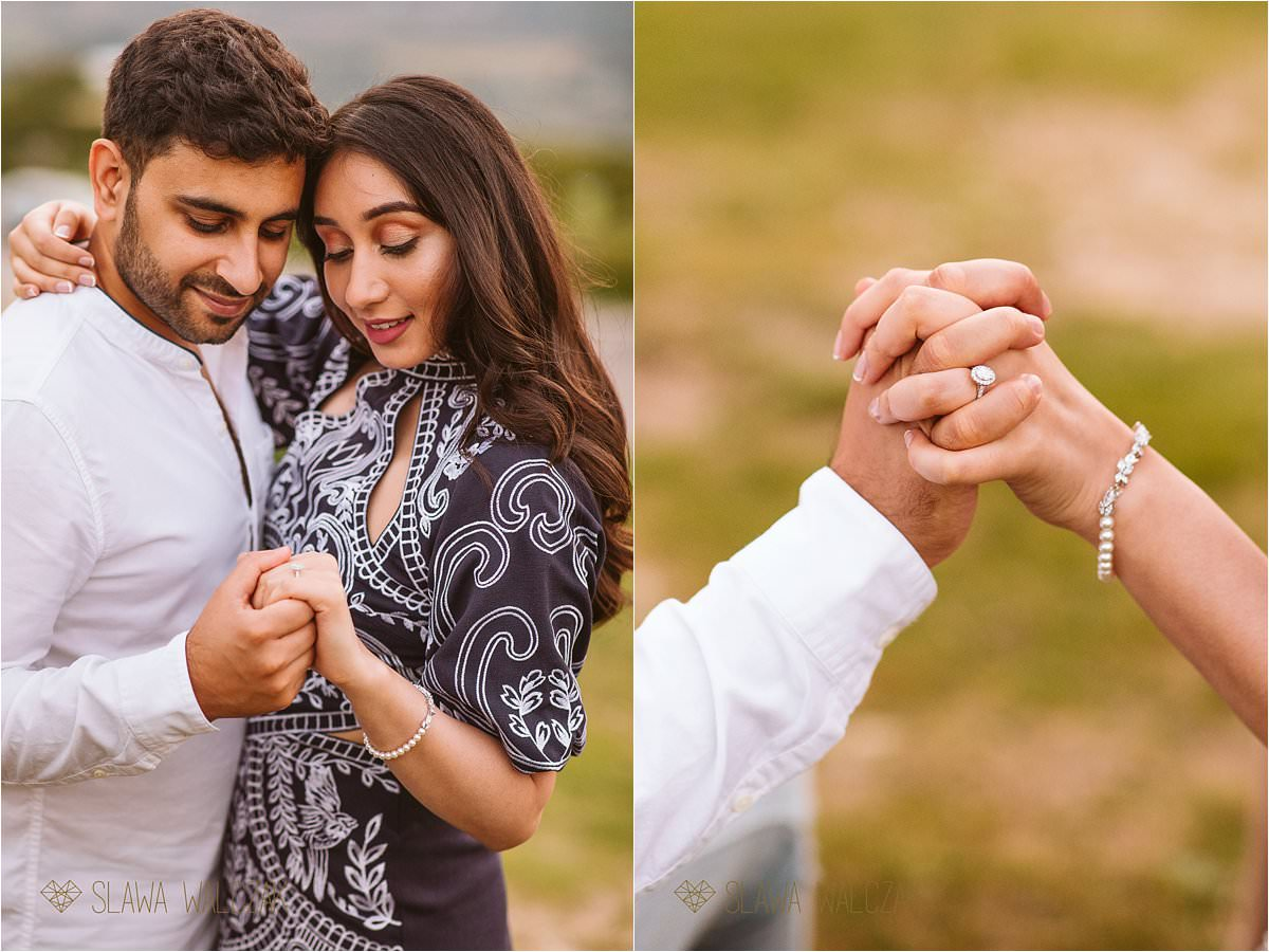 couple looking at the engagement ring while posing for their pre wedding shoot