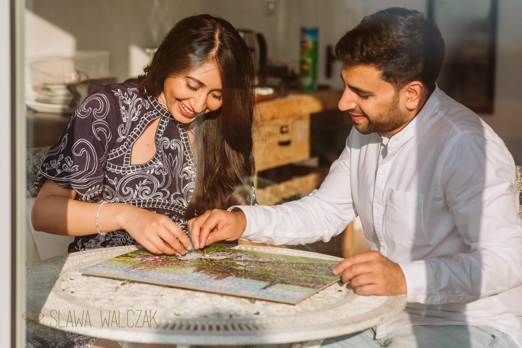 Cheltanham couple doing their engagement puzzles