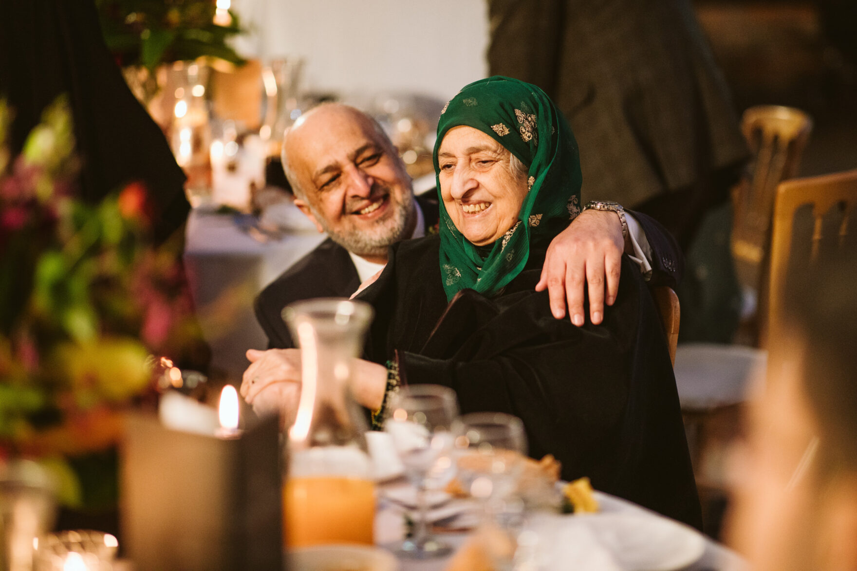 Father of the bride chatting to the grandma at a Muslim Wedding